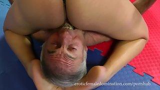 Strong Girl In Black PVC Corset Wrestling Video