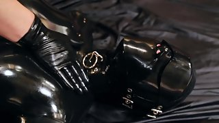 Restrained in rubber and tickled until it screams